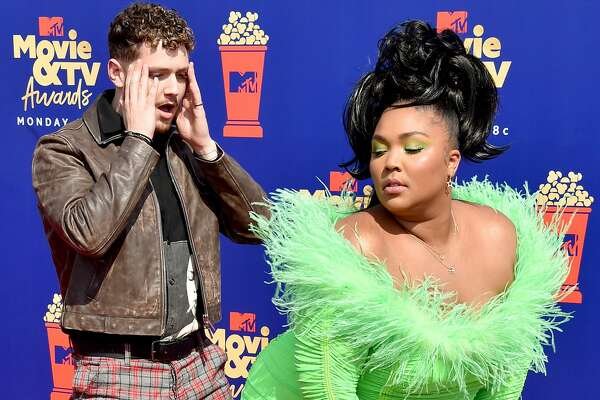 SANTA MONICA, CALIFORNIA - JUNE 17: (L-R) Bazzi and Lizzo attend the 2019 MTV Movie and TV Awards at Barker Hangar.