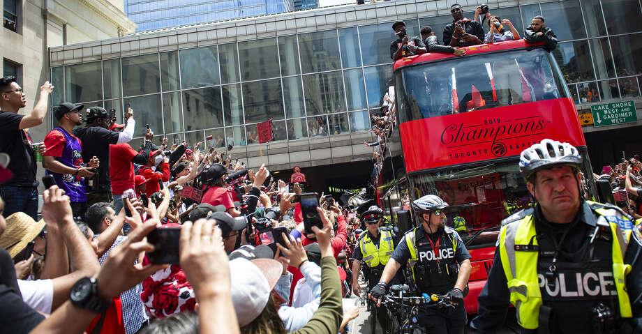 Toronto Raptors fans watch as their team parade through downtown Toronto celebrating their first NBA Championship title on June 17, 2019 in Ontario, Canada. Two people were reportedly shot near the square where people were celebrating, and two people have been taken into custody. (Eduardo Lima/Zuma Press/TNS) Photo: Eduardo Lima/TNS
