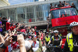 Toronto Raptors fans watch as their team parade through downtown Toronto celebrating their first NBA Championship title on June 17, 2019 in Ontario, Canada. Two people were reportedly shot near the square where people were celebrating, and two people have been taken into custody. (Eduardo Lima/Zuma Press/TNS)