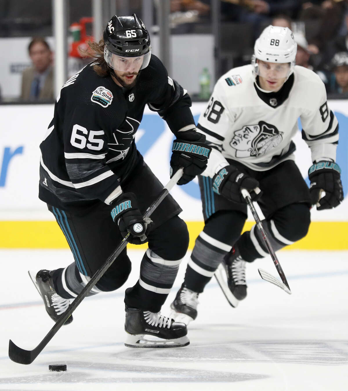 Pacific's Erik Karlsson heads up ice against Central's Patrick Kane during Central's 10-4 win in 2019 NHL All Star Game semifinal at SAP Center in San Jose, Calif., on Saturday, January 26, 2019.