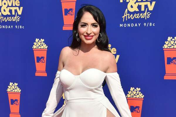 SANTA MONICA, CALIFORNIA - JUNE 17: Angelina Pivarnick attends the 2019 MTV Movie and TV Awards at Barker Hangar.