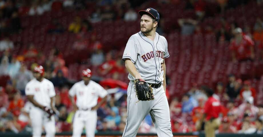 Houston Astros starting pitcher Wade Miley walks back to the dugout after being relieved in the fifth inning of a baseball game against the Cincinnati Reds, Monday, June 17, 2019, in Cincinnati. (AP Photo/John Minchillo) Photo: John Minchillo/Associated Press