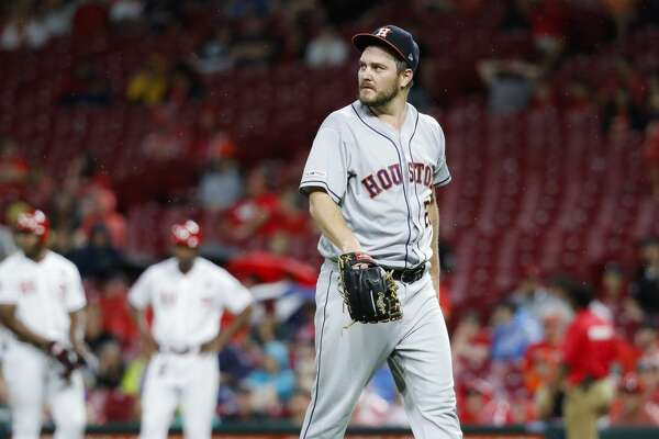 Houston Astros starting pitcher Wade Miley walks back to the dugout after being relieved in the fifth inning of a baseball game against the Cincinnati Reds, Monday, June 17, 2019, in Cincinnati. (AP Photo/John Minchillo)
