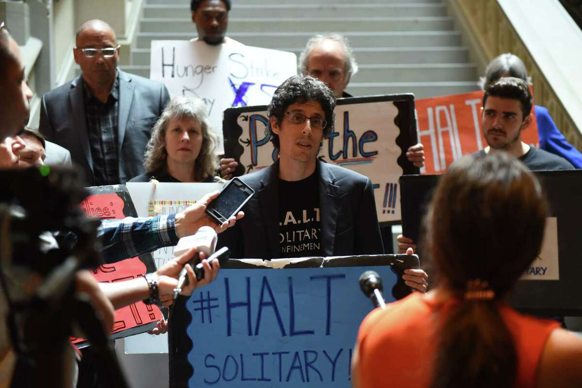 Scott Paltrowitz, an advocate with Correctional Association of New York, speaks during a press conference to urge passage of the Humane Alternatives to Long-Term (HALT) Solitary Confinement Act on Monday, June 17, 2019, at the Capitol in Albany, N.Y. Advocates and solitary confinement survivors are on a five-day hunger strike to bring awareness to their cause. (Will Waldron/Times Union)