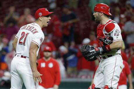 Reds reliever Michael Lorenzen celebrates with catcher Curt Casali after striking out Astros rookie slugger Yordan Alvarez to end Monday night's game at Great American Ball Park.