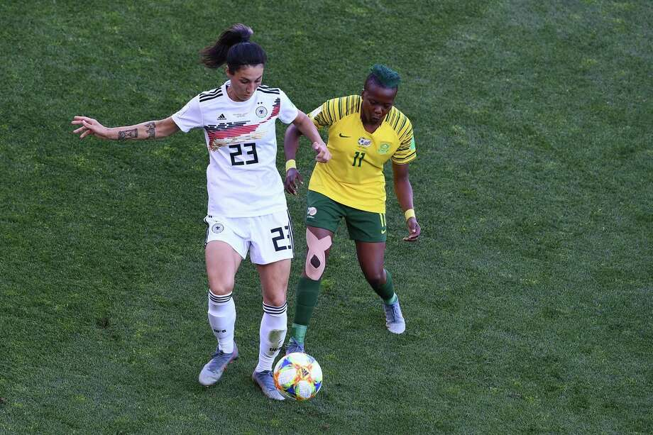 Germany's defender Sara Doorsoun (L) vies for the ball with South Africa's forward Thembi Kgatlana during the France 2019 Women's World Cup Group B football match between South Africa and Germany, on June 17, 2019, at the Mosson Stadium in Montpellier, southern France. (Photo by Boris HORVAT / AFP)BORIS HORVAT/AFP/Getty Images Photo: BORIS HORVAT / AFP or licensors