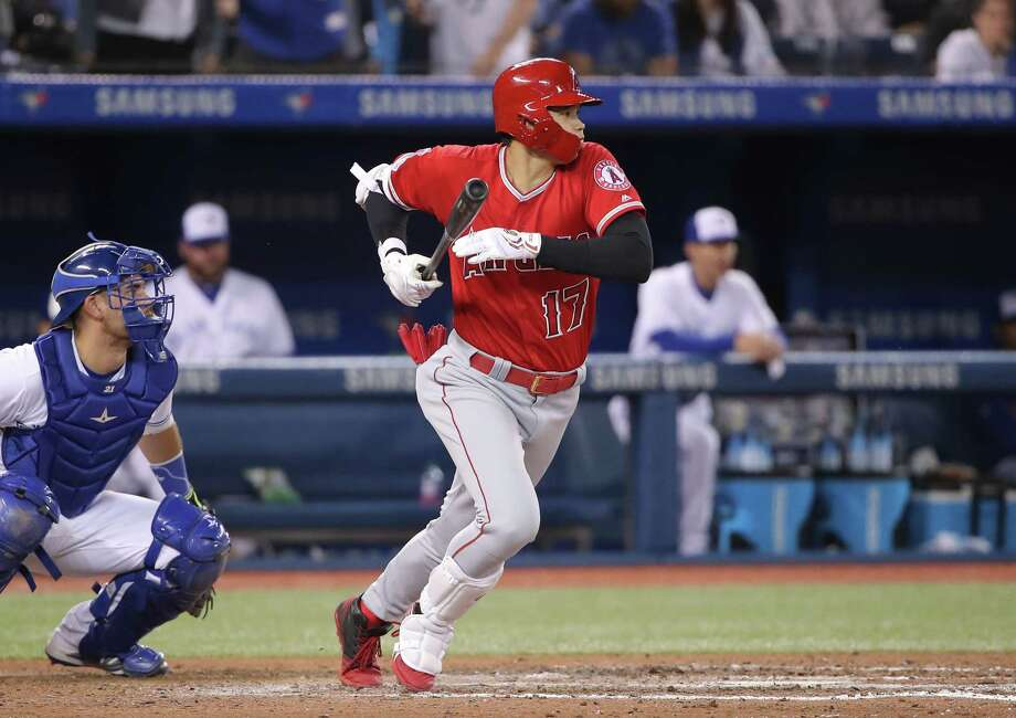 TORONTO, ON - JUNE 17: Shohei Ohtani #17 of the Los Angeles Angels of Anaheim hits into a fielders choice in the eighth inning during MLB game action against the Toronto Blue Jays at Rogers Centre on June 17, 2019 in Toronto, Canada. (Photo by Tom Szczerbowski/Getty Images) Photo: Tom Szczerbowski / 2019 Getty Images