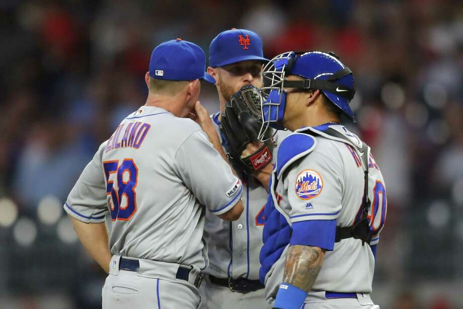 ATLANTA, GA - JUNE 17: Zack Wheeler #45 of the New York Mets speaks with Wilson Ramos #40 and pitching coach Dave Eiland in the fifth inning of an MLB game against the Atlanta Braves at SunTrust Park on June 17, 2019 in Atlanta, Georgia. (Photo by Todd Kirkland/Getty Images) Photo: Todd Kirkland / 2019 Getty Images