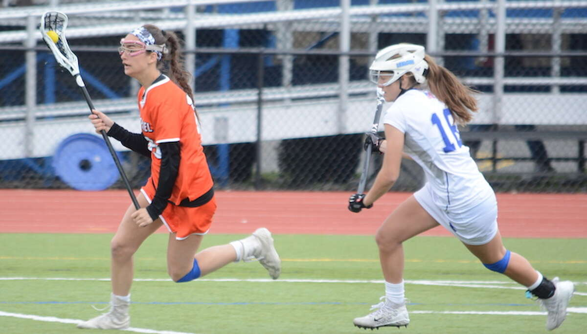 Aly Gagnon is pursued by a Ludlowe defender during Saturday's game. - Andy Hutchison photo