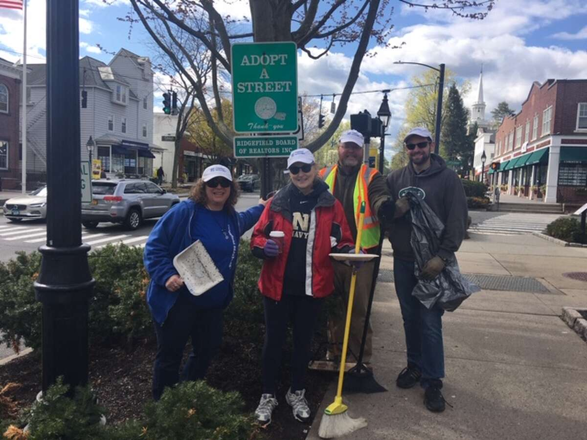 Ridgefield Board of Realtors were out collecting trash Saturday on Main Street.