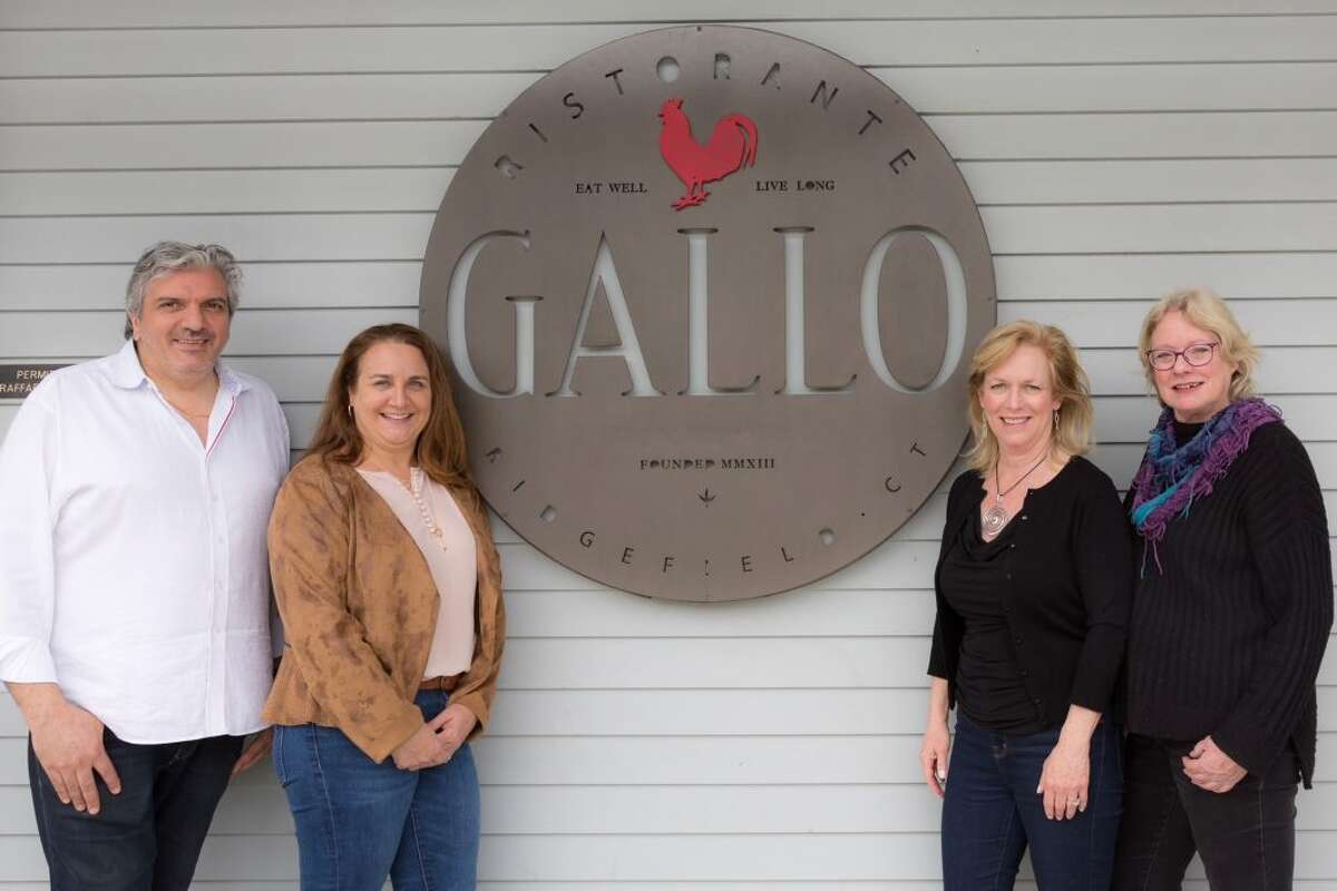Restaurant owner Raffaele Gallo, Ridgefield Guild of Artists' Executive Director Pam Stoddart and guest bartenders Tina Sturges and Mary Harold.