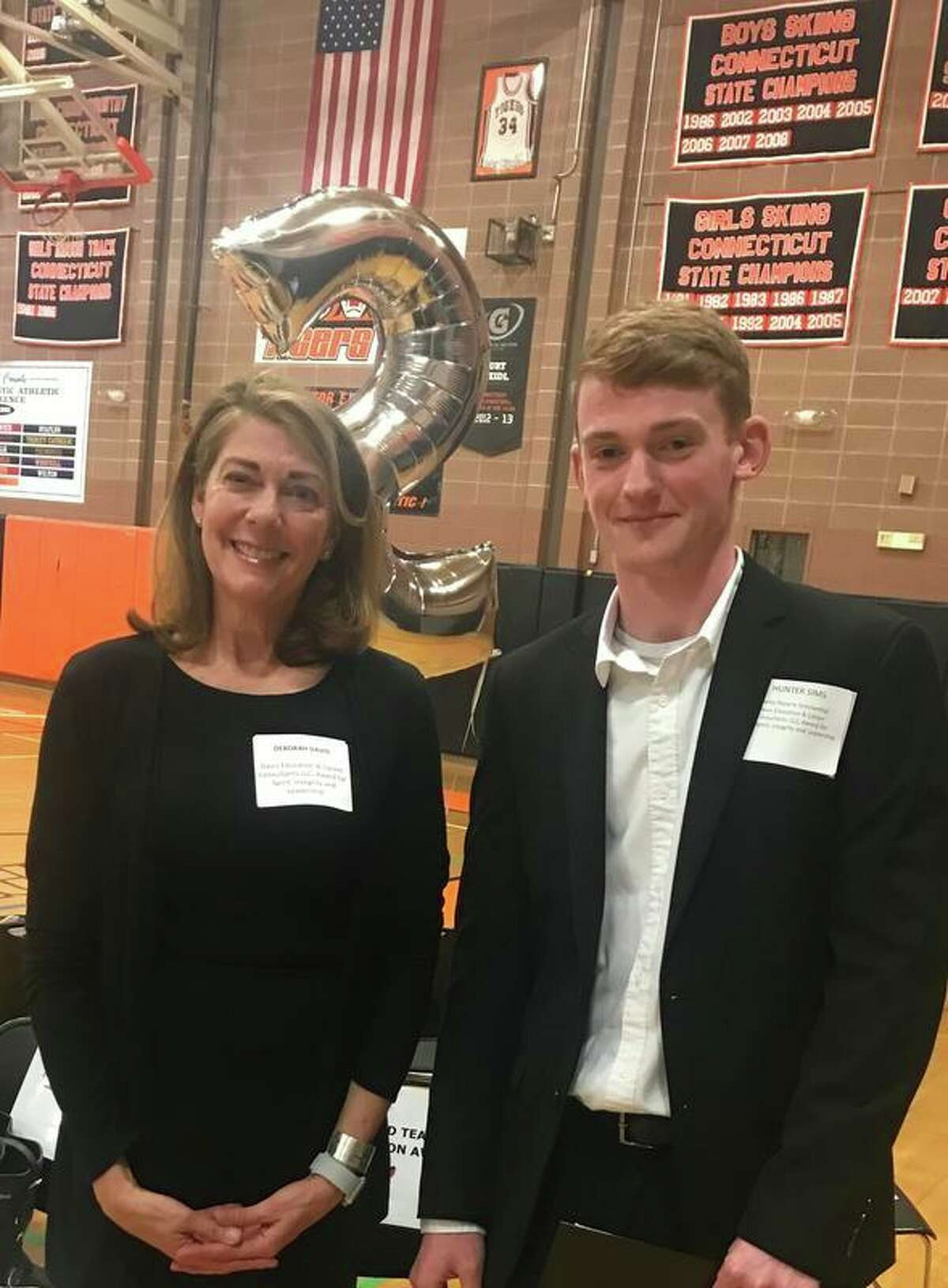 Deborah Davis, president of Davis Education and Career, with Ridgefield High School senior Hunter Sims. Sims, a talented jazz musician, was chosen as Davis' 2019 scholarship recipient based on academics, integrity, leadership and spirit. He will be attending the University of North Texas in the fall.