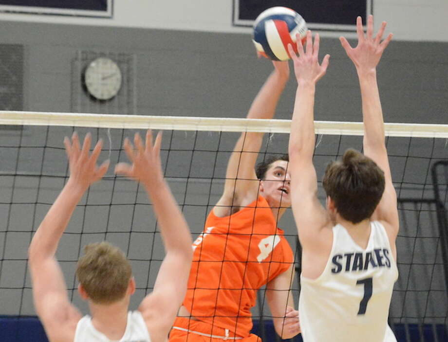 Andrew Masciotti goes for a kill in Monday's match with Staples. — Andy Hutchison photo