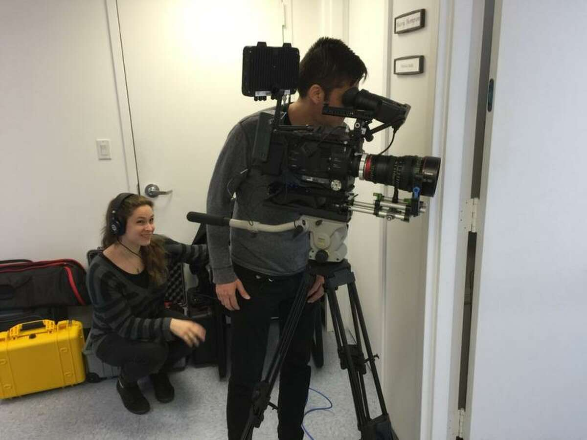 Filmmakers from JTFM productions at work in the studio.