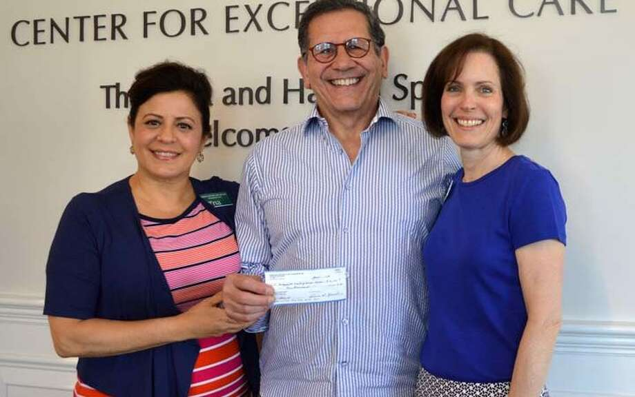 Rotarian Rich Vazzana (center) presents grant to RVNA President & CEO Theresa Santora (left) and RVNA Director of Philanthropy MJ Heller last summer. Vazzana was appointed to the Planning and Zoning Commission Tuesday, April 16.