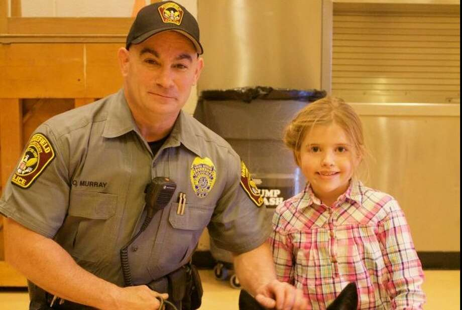 Ridgefield police Officer Sean Murray will be promoted to sergeant next week. He posed for a picture with Scotland Elementary School fifth grader Rilynn Mahoney last year.