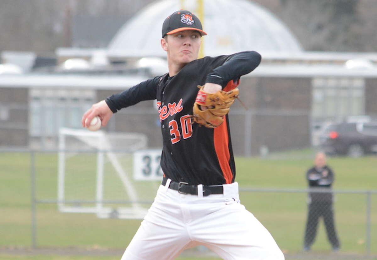 Matt DeLuca throws a pitch during Ridgefield's 2-0 win over Trumbull. - Andy Hutchison photo