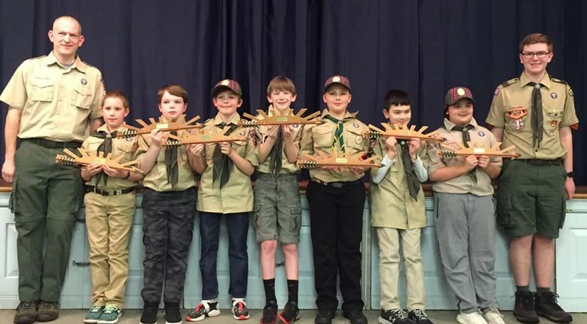At Pack 126's annual Blue and Gold Dinner, seven Webelos scouts earned the Arrow of Light. From left to right: Den Leader Mark Hankla, Evan Joyce, Terry Herlihy, Ian Wallace, Jacob Hankla, Hunor Hagen, Caden Shiffer, Liam Bishop, and Den Chief Conor Hankla. The Arrow of Light is the highest award in cub scouting.