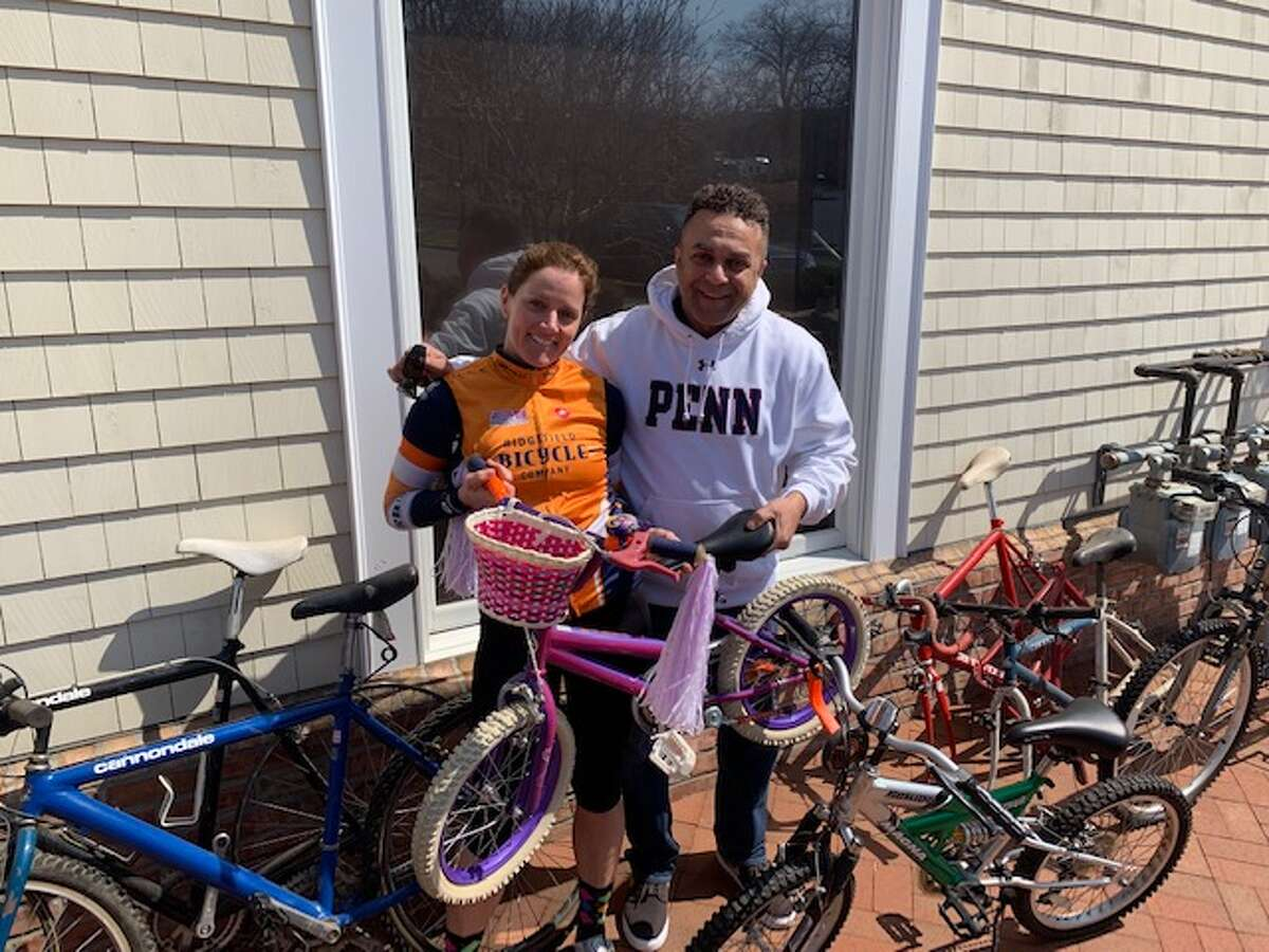Ridgefield Bicycle Company hosted its annual spring bicycle donation drive last weekend. Over 100 bikes were collected and will be refurbished and distributed to local Fairfield County charities by Northeast Community Cycles. Owner Jacqui Dowd accepted three bicycles from Ridgefielder Scott Kemp.