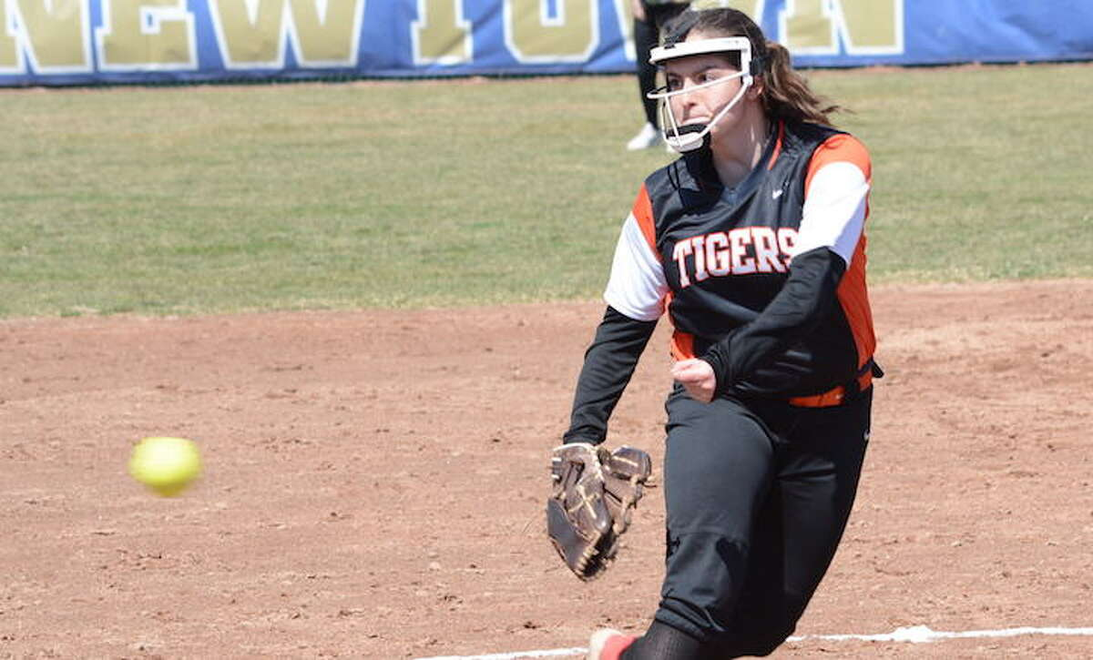 Skylar Arent throws a pitch during Ridgefield's loss to Newtown on Saturday. - Andy Hutchison photo
