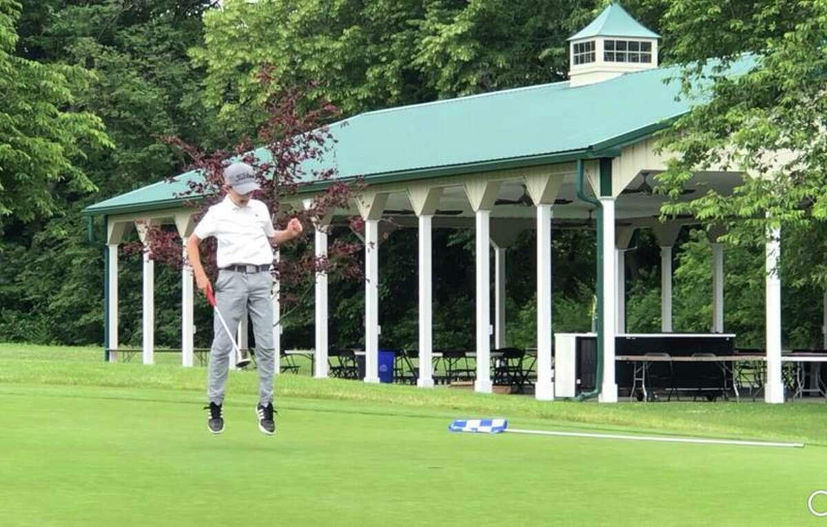 Ridgefield resident Asher Katz sinks a putt for par at the Bethlehem Golf Course in Bethlehem, Pa. Katz qualified for the Optimist International World Championship at the Bethlehem competition on June 17.