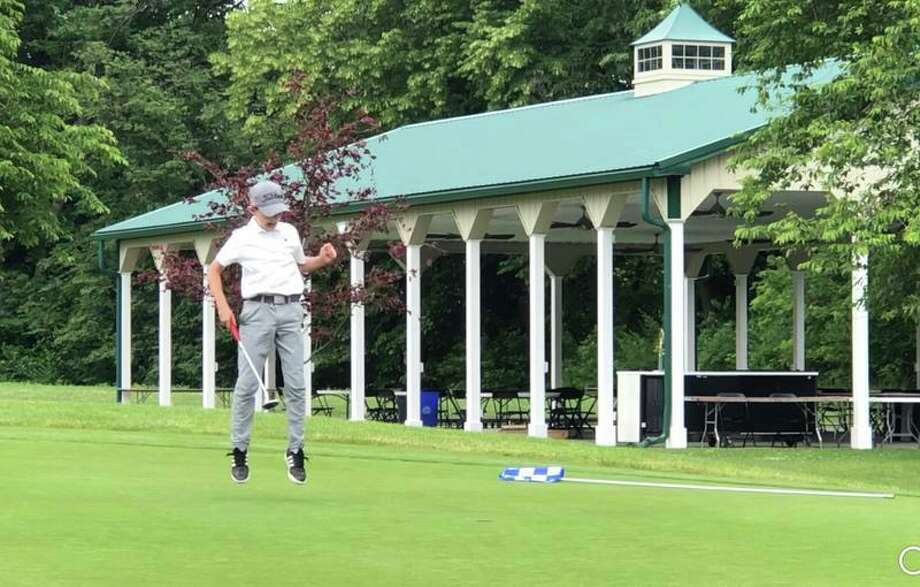 Ridgefield resident Asher Katz sinks a putt for par at the Bethlehem Golf Course in Bethlehem, Pa. Katz qualified for the Optimist International World Championship at the Bethlehem competition on June 17.