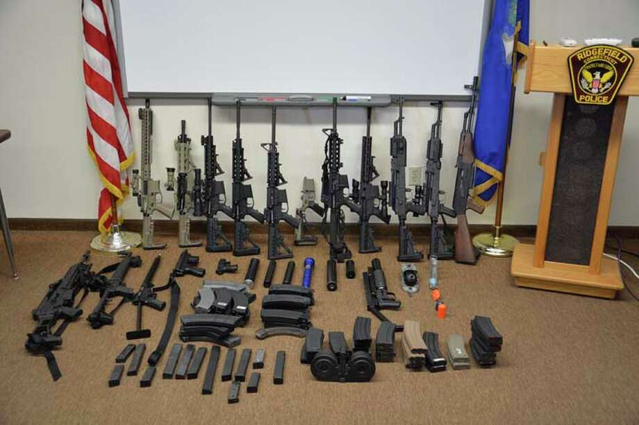 A cache of rifles and other firearms were seized from a Tackora Trail home Thursday, March 28. The weapon's owner, Mark Albin, is scheduled to appear in court June 5. — Ridgefield Police Department photo