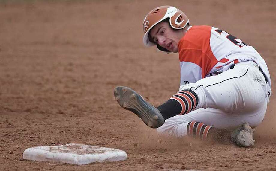 Cole Blackwell slides into third base during Ridgefield's 5-1 win over Weston. — Scott Mullin photo / Scott Mullin ownership