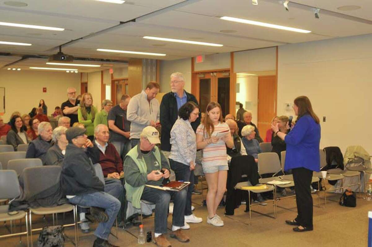 Residents line up to ask question at the League of Women Voters forum over the weekend. - Macklin Reid photo