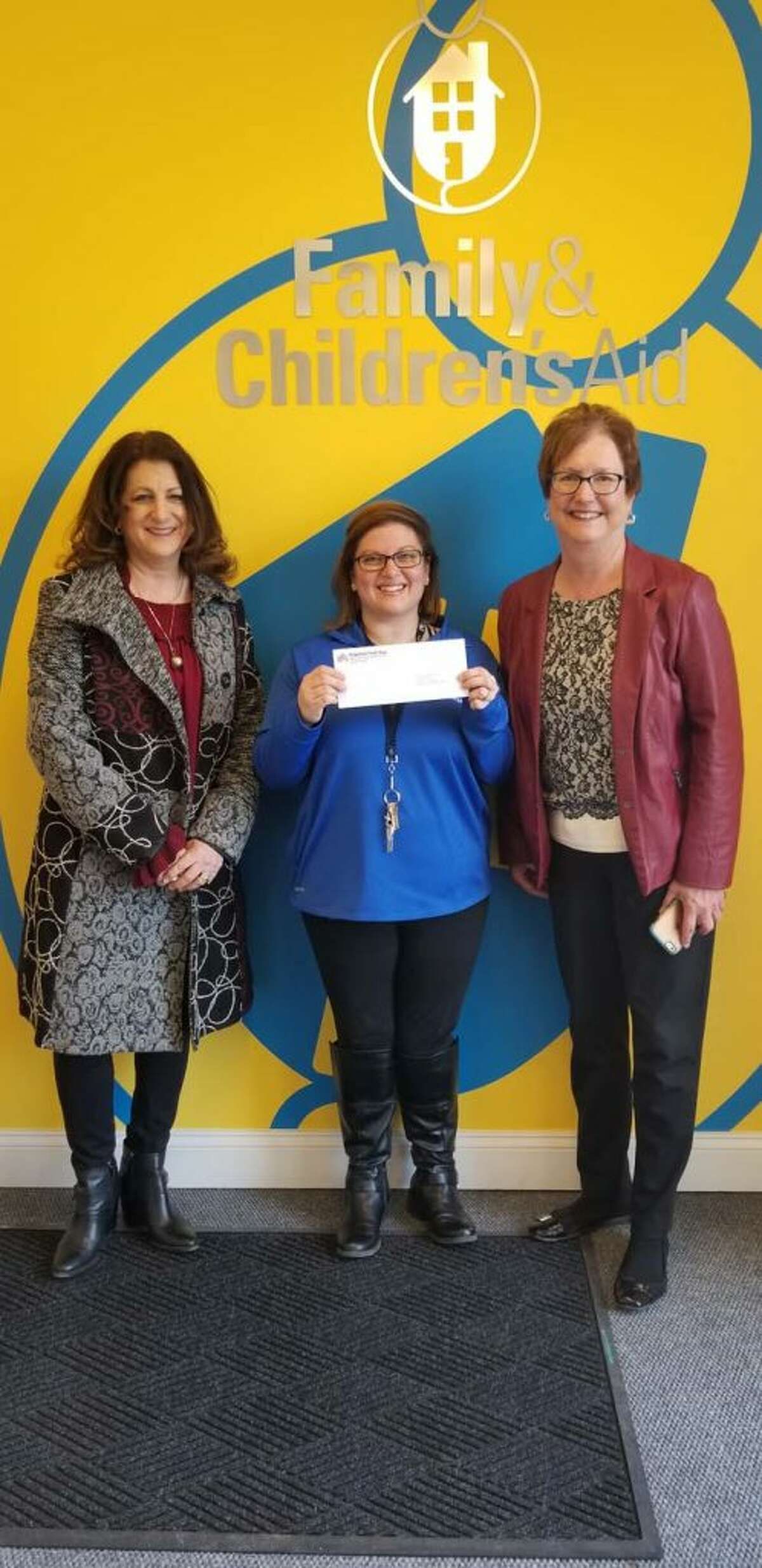 From left to right: Sandra Capriotti, Ridgefield Thrift Shop president; Allison Carballo, director of development for Family and Children's Aid (FCA); and Debbie Murphy, Thrift Shop finance committee chair. The grant from the Thrift Shop will support FCA's mission, services and programs, and benefit clients in need.