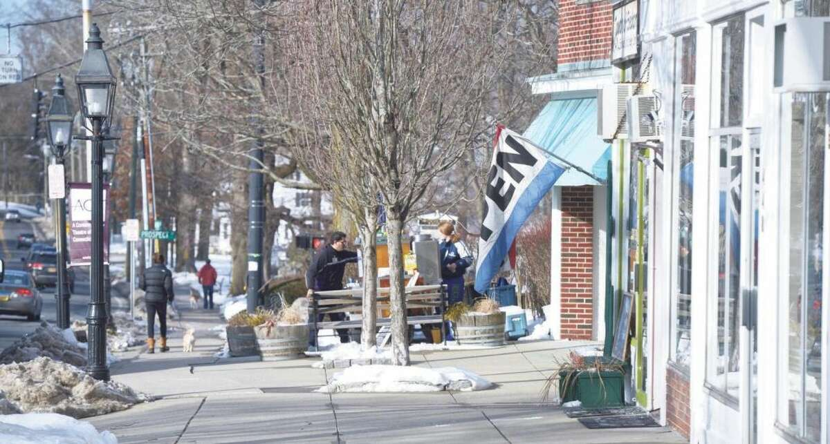 Strolling customers on Main Street might be able to access the Internet by using free public Wi-Fi.