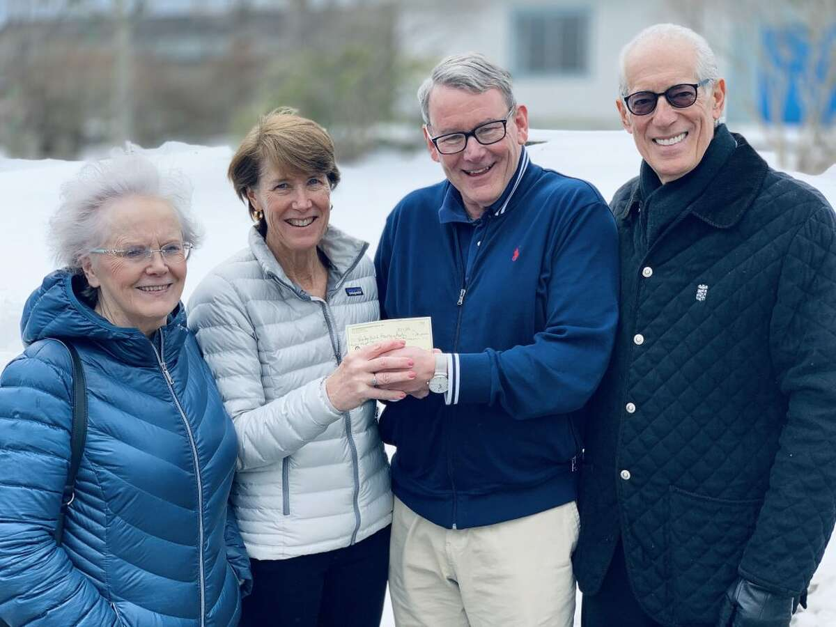 Left to right: Cathy Potel of the Ridgefield Thrift Shop; Carol Gardell, treasurer of the Ridgefield Thrift Shop; Frank Coyle, chairman of Ridgefield Housing Authority; and Vincent Liscio, Commissioner of Ridgefield Housing Authority.