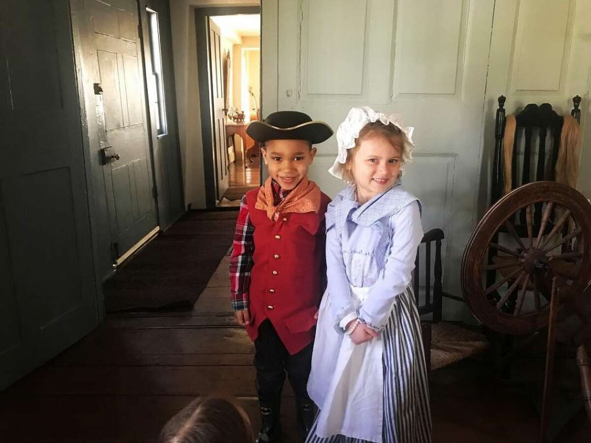"""On March 28, students from Jesse Lee Day School's """"Doves"""" class visited The Keeler Tavern to learn about life 300 years ago. Jackson Owen and Liliana Tarlton, both from Ridgefield, dressed-up in period clothes to show us what children wore back in the day. -Stephanie Firstbrook photo"""