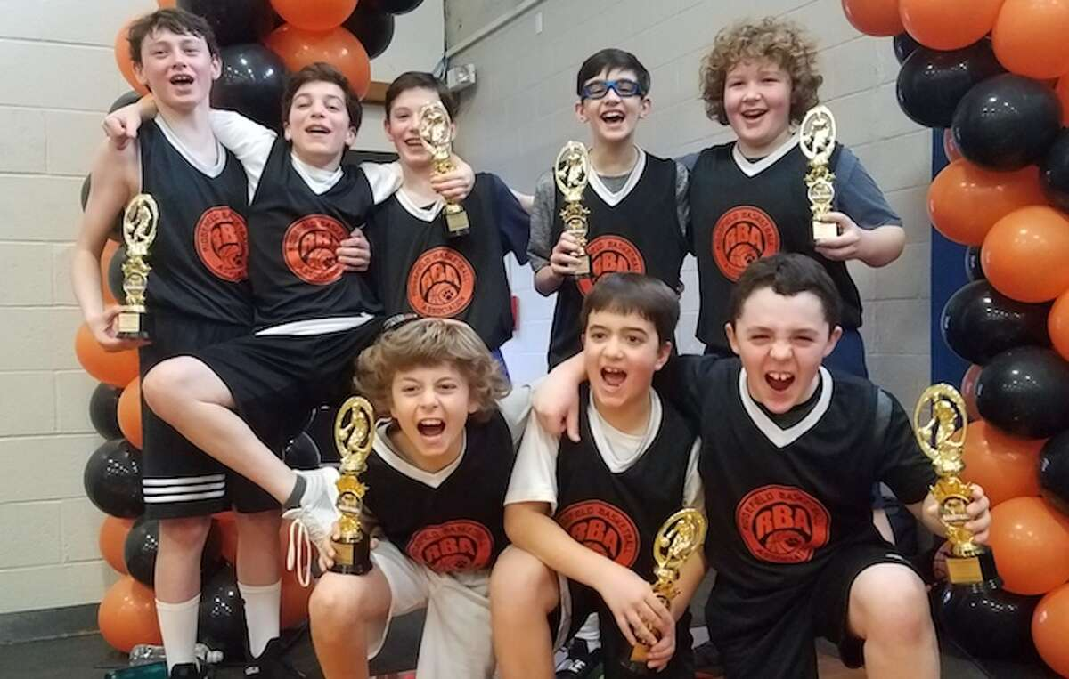 Bucknell celebrates its title in the RBA 6th/7th grade boys house division. Back row (left to right): James Feenan, Justin Agliardo, Chris Keating, Caleb Kaufman, WillCarter; front row: Sam Young, Nico Genna, J.J. Schachinger.