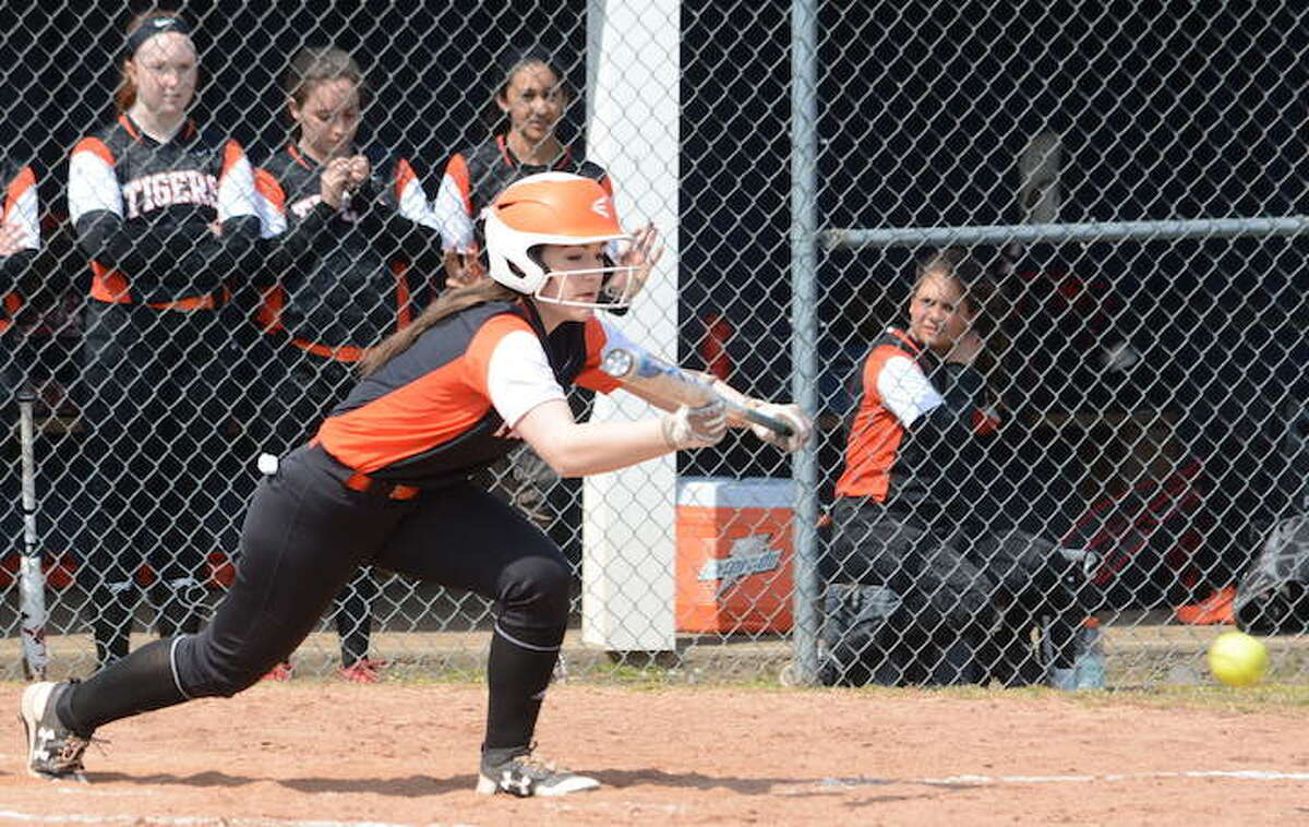 Claire Filaski lays down a bunt during Ridgefield's season opener against Staples. - Andy Hutchison photo