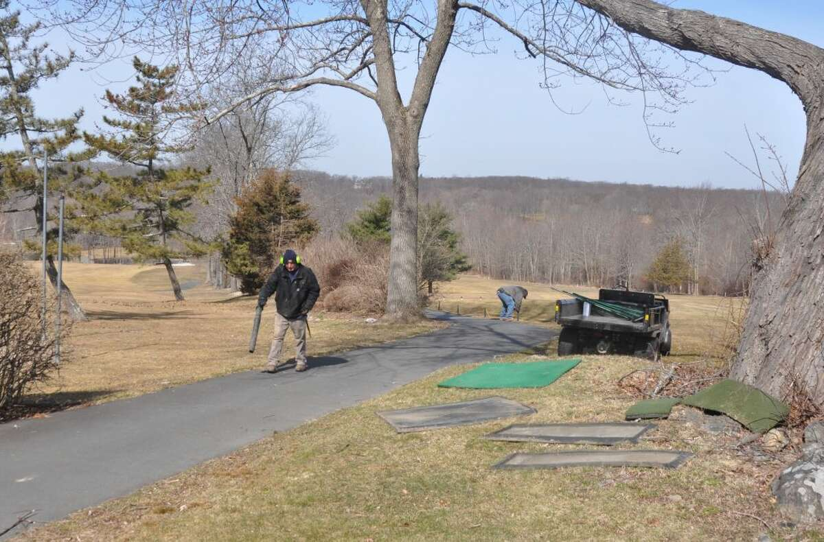 Workers were out Thursday morning readying the Ridgefield Golf Course for its spring opening Friday, March 29, 2019. - Macklin Reid/Hearst Connecticut Media