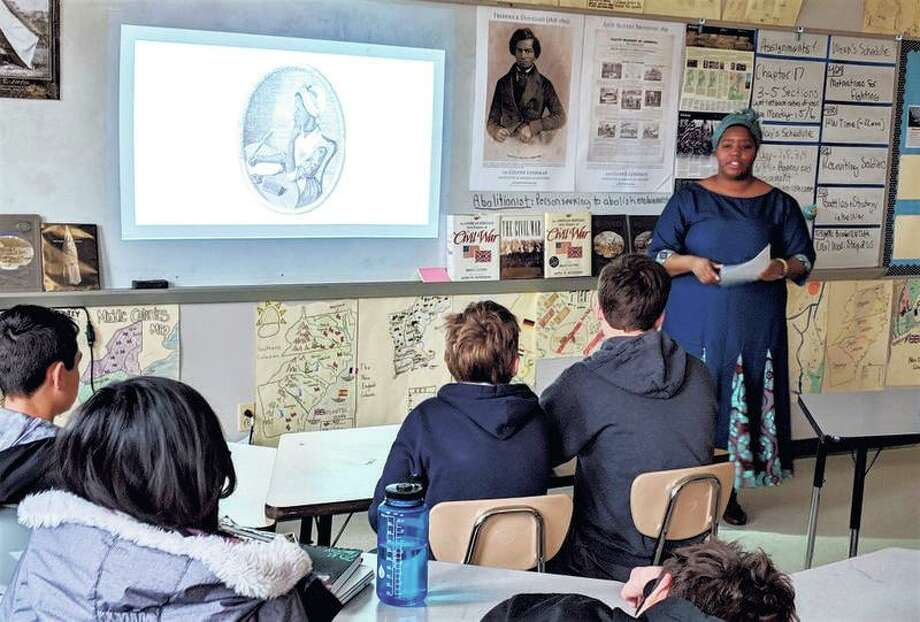 Historical interpreter Cheyney McKnight examines the life of 18th century enslaved poet Phillis Wheatley to teach 8th grade Scotts Ridge Middle School students about using their voices to effect change.