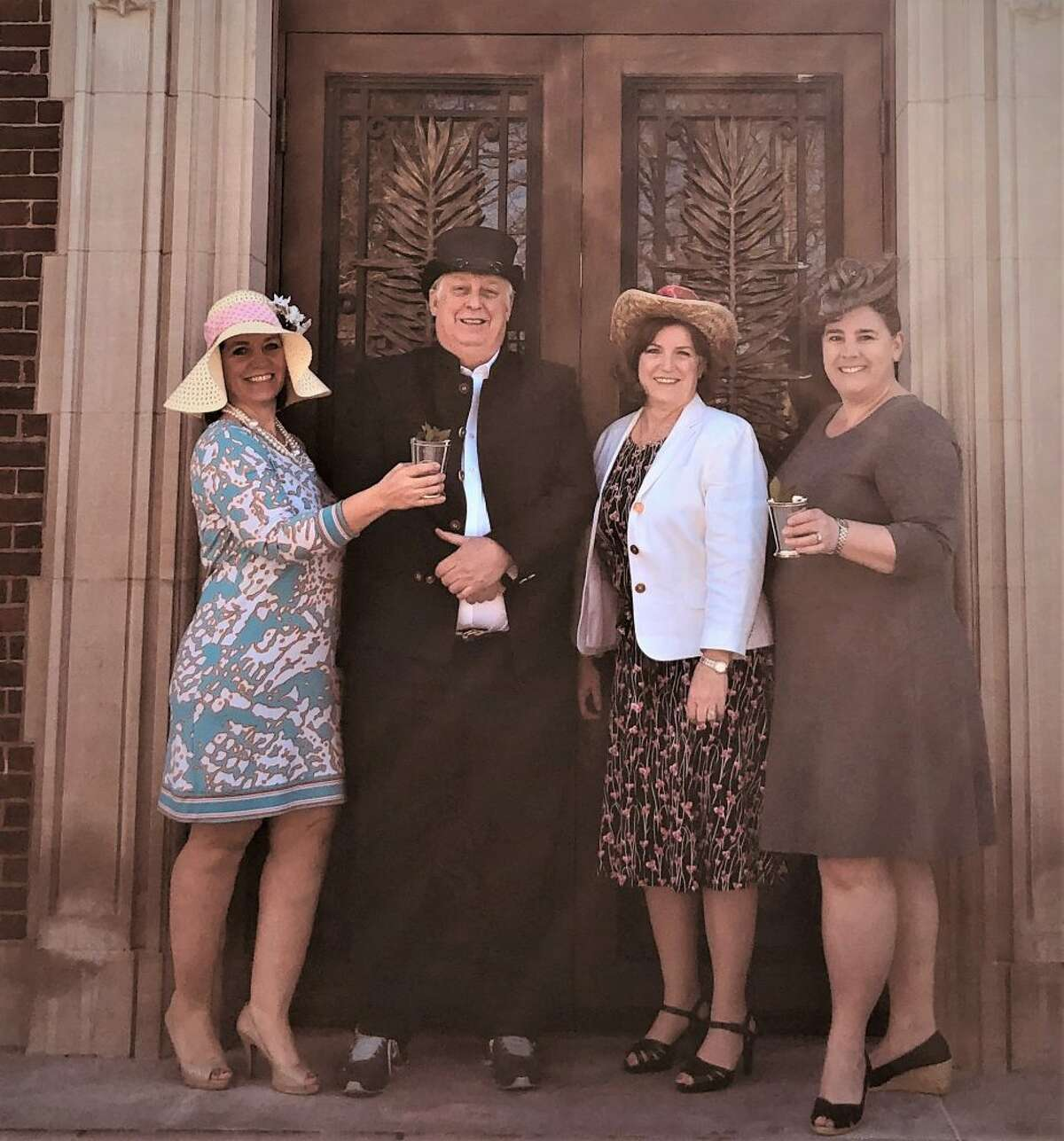 The Ridgefield Library will be hosting a Kentucky Derby-themed gala. Committee members, from left to right, Michele Booth, Rob Ellis, Julie Yaun and Lynn Everdell prepare for the 145th Run for the Roses by donning derby-inspired outfits in front of the library.