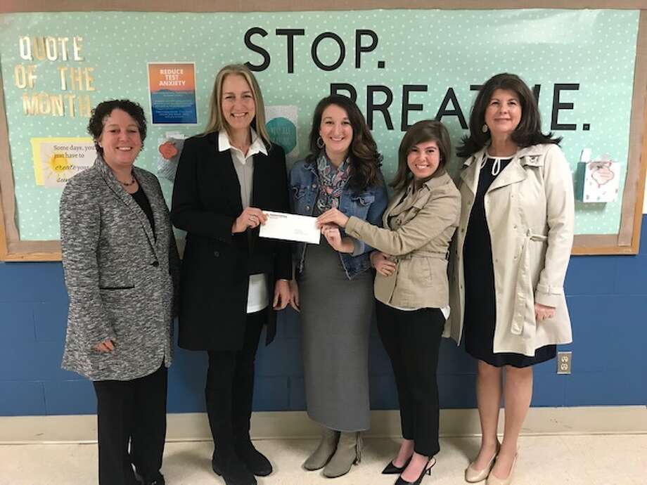 Pictured, from left to right: Tricia Raneri, principal of East Ridge Middle School; Pamela Simoneau, Thrift Shop volunteer;  Blair Posson, Teen Talk counselor at East Ridge Middle School; Alexandra Salame, Teen Talk counselor at Ridgefield High School; and Denise Qualey, managing director of clinical service at Kids in Crisis. Missing from picture is RHS Principal Dr. Stacey Gross.