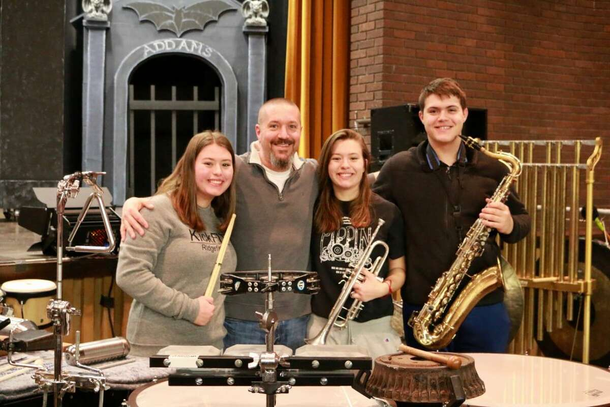 """The DiMiceli family is playing in the Ridgefield High School orchestra for The Addams Family, and dad Greg says, """"it's a thrill."""" From left-right, Sarah, Greg, Emma and Brendan DiMiceli."""