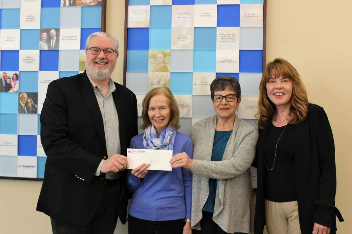 Regional Hospice and Palliative Care has received a donation from the Ridgefield Thrift Shop. Pictured, left to right: Paul Sirois, Jayne Flynn, and Deborah deKoff, vice president of philanthropy.