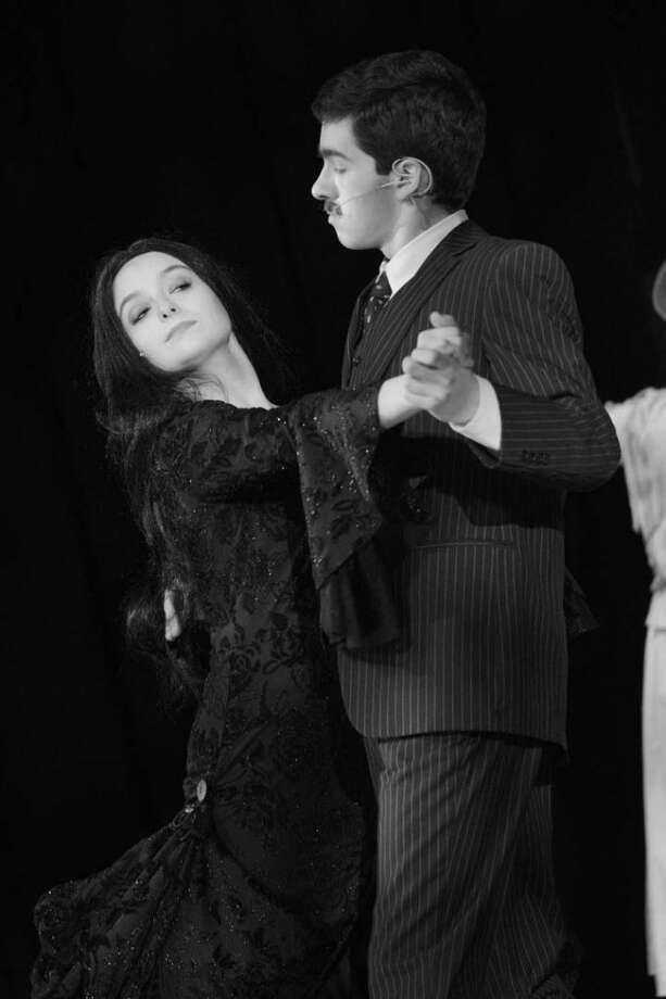 RHS Seniors Evan Smolin and Emily Parker are Gomez and Morticia Addams in the The Addams Family, shown here dancing the Tango de Amor. The final two shows of the musical comedy are March 22 and 23 at 7:30 p.m. in the Ridgefield High School auditorium. Tickets are sold at the door and online at rhsperformingarts.info/