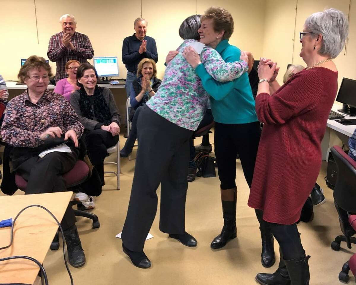 Grace Weber, Founders Hall executive director, excitedly looks on as Cindy Nesbitt, Founders Hall director of development, thanks Toni Maiolo from Ridgefield Thrift Shop for their generous gift.