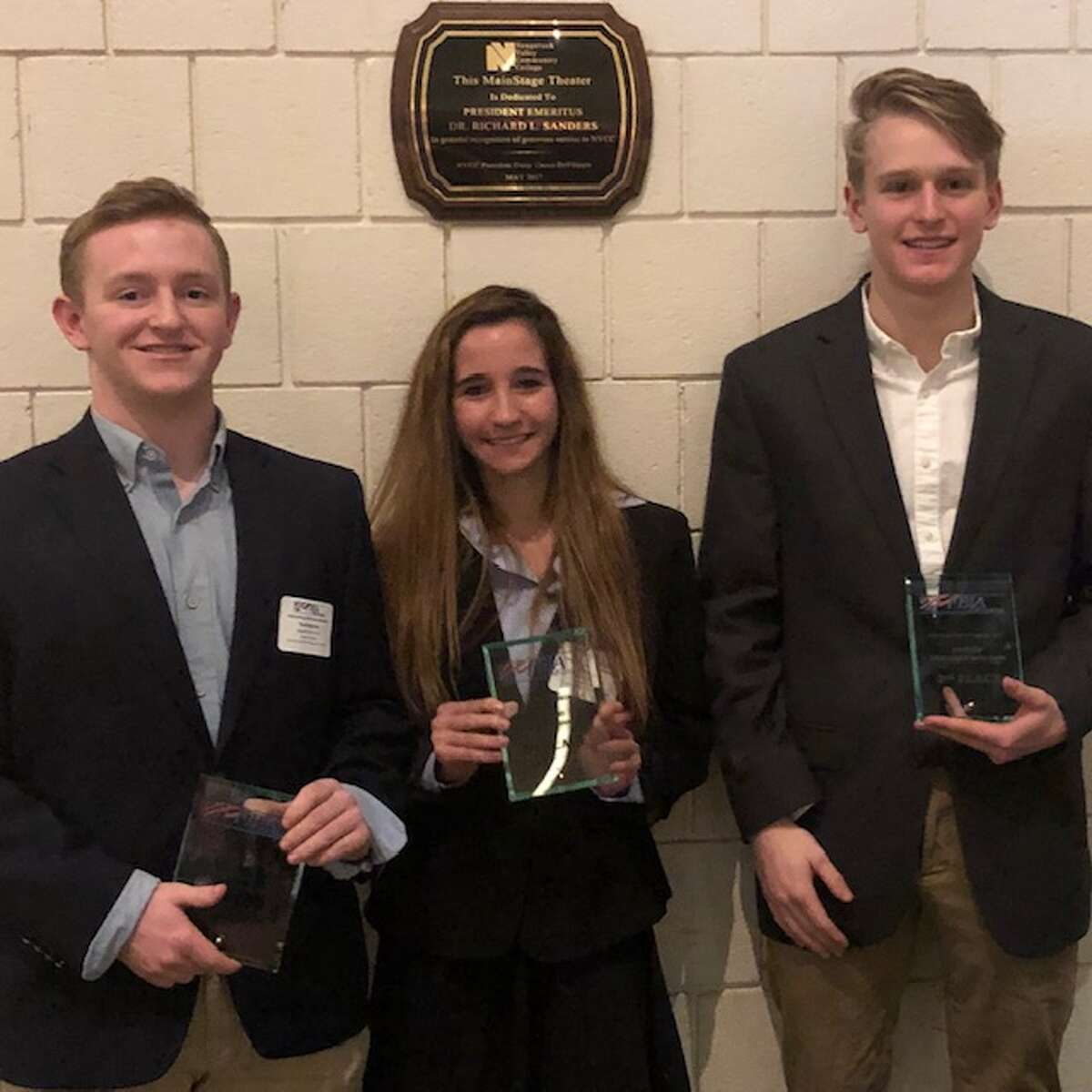 Ryan Bogursky, Alyssa Maiolo, Heston Pinard won second place in sports and entertainment marketing at the Future Business Leaders of America conference at Naugatuck Community College in Waterbury on March 12.
