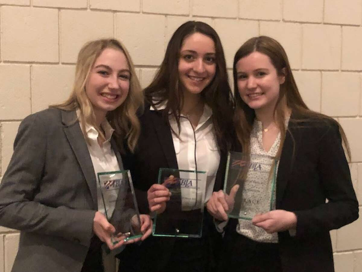 Lauren Thompson, Juliette Castagna, and Sarah Isaac finished in first place in global business at the FBLA spring conference in Waterbury earlier this month.