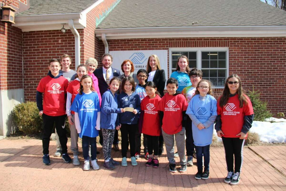 Members of the Boys and Girls Club were on hand to receive a check from the Ridgefield Thrift Shop Thursday, March 14.