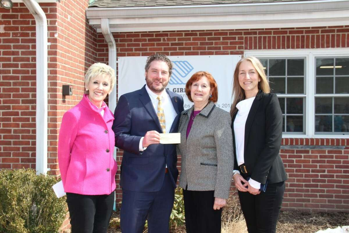 Thrift shop volunteers Anita Vallee, Suzanne Conlin and Pamela Simoneau present a check to Mike Flynn, Executive Director of the Boys & Girls Club of Ridgefield.