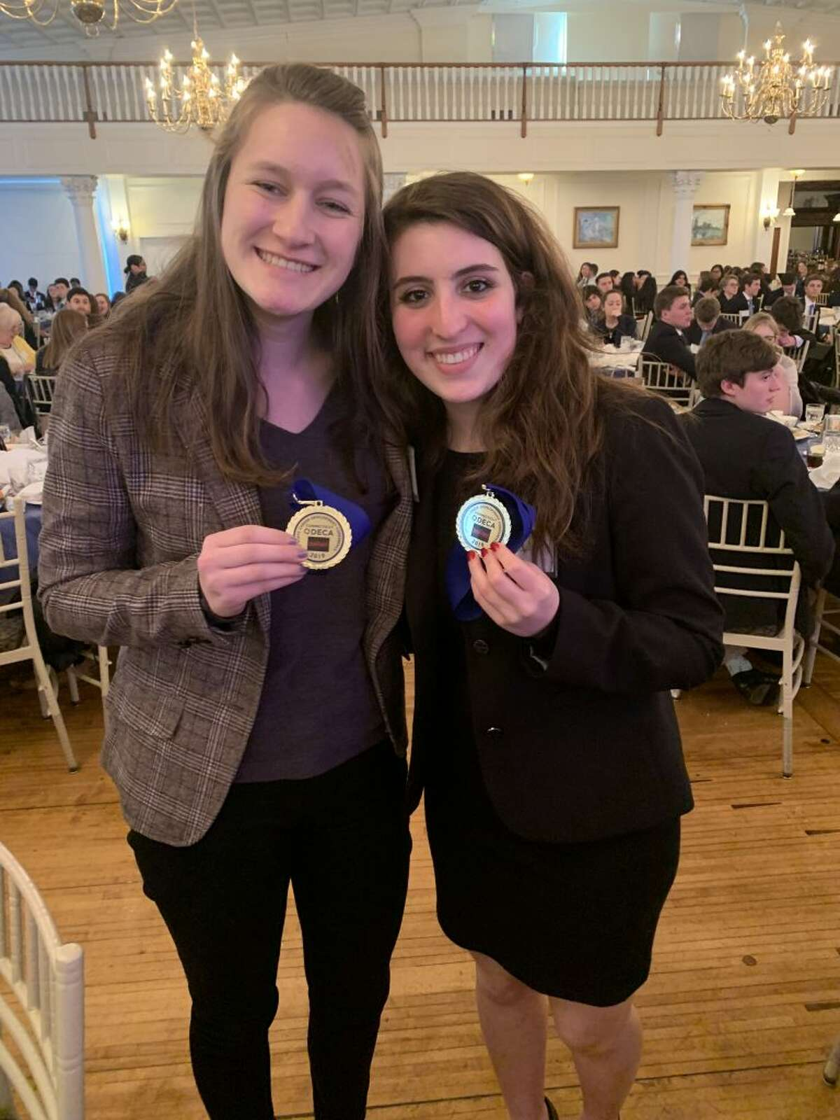 Ridgefield High School senior Allison Catizone and RHS sophomore Avery Simoneau placed sixth in the financial services category at the DECA state competition on March 5.
