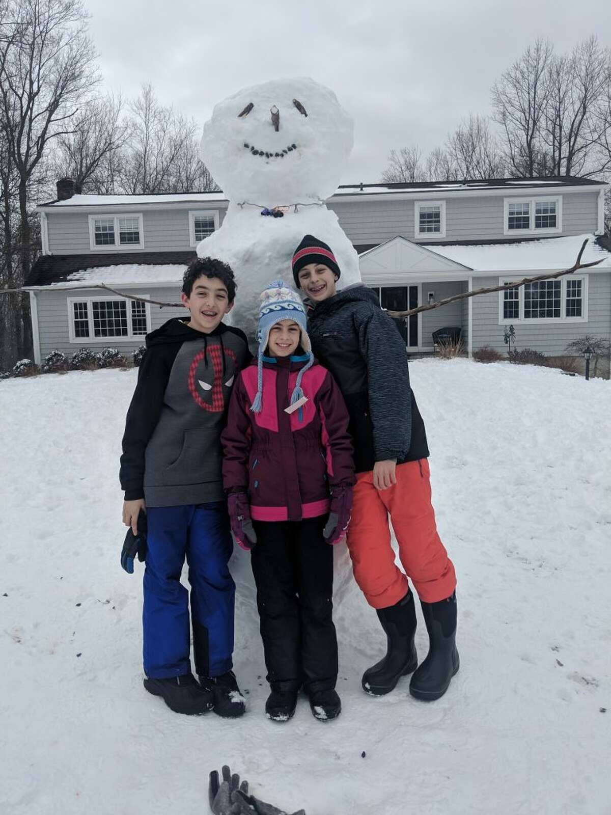 """Who's got the tallest snowman in town? It's got to be the Smuckler children Zach, Griffin and Leah who build this 10-foot giant over the weekend. They've got plenty of fresh powder to build a replica today. """"They worked hard to hoist that head up there,"""" said mom Carrie Smuckler."""