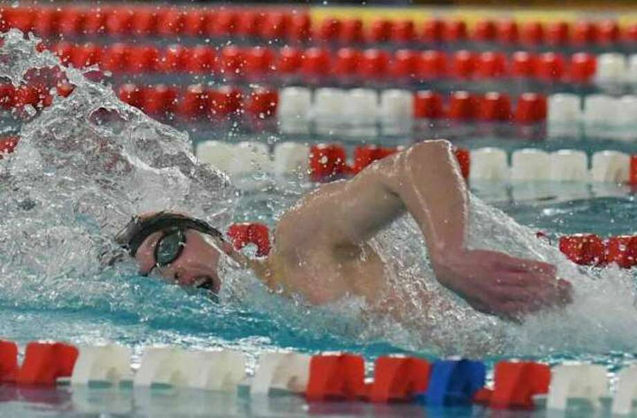 Ridgefield sophomore Connor Hunt swims to first place in the 500-yard freestyle at the FCIAC championship meet. Hunt also triumphed in the 200 freestyle. Photo: Gregory Vasil / Hearst Connecticut Media